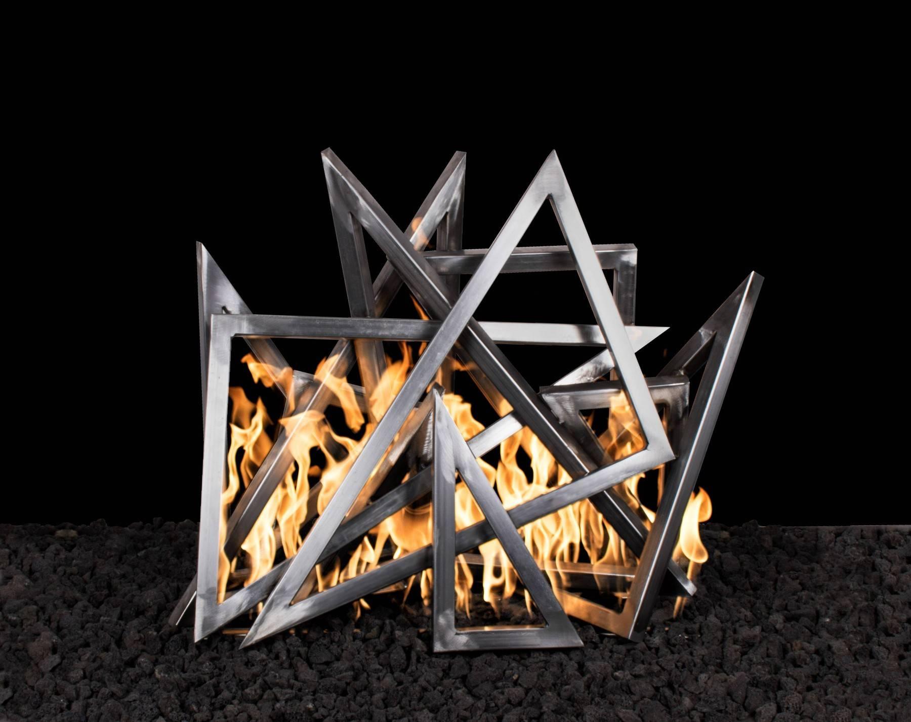 Steel Triangle Sculpture Sets Over Existing Burner