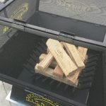 """24"""" x 24"""" Steel Wood Fire Pit with Open Screen and Wood"""